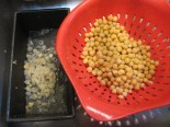 Some people take the time to remove the outer layer off of the chickpeas after cooking.  I don't find that this extra effort changes the taste or texture.  Remember to save a half a cup of the cooking water.