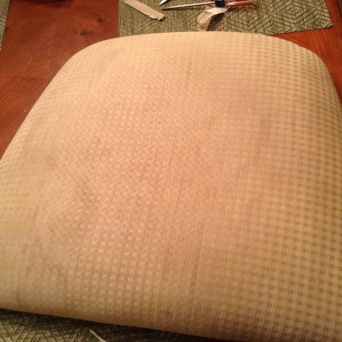 Ewwwww. Here's an old cushion unscrewed from the chair frame and ready to redo. I didn't need to replace any cushion foam or batting--the only thing that was in poor shape was the fabric itself.