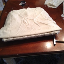 Images of stapling the fabric have vanished! But, I mimicked how the old cushion looked.